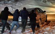 بارش سنگین برف «گردنه گله بادوش» الیگودرز را مسدود کرد